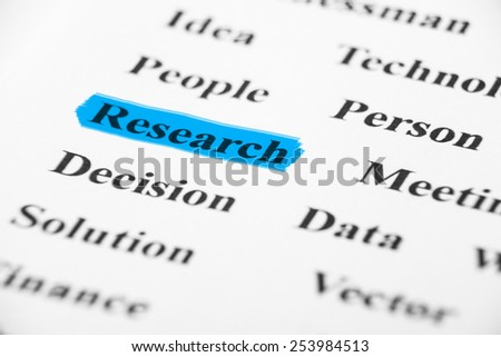 Research with some other related words on paper. - stock photo