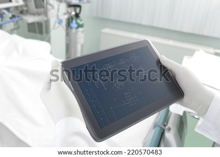 Research with Tablet PC in the engineering laboratory  - stock photo