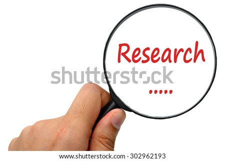 research word. Magnifier and puzzles. - stock photo