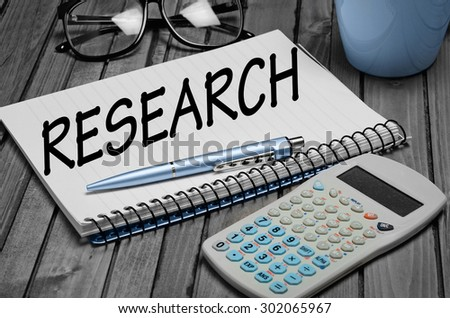Research word on notepad closeup - stock photo