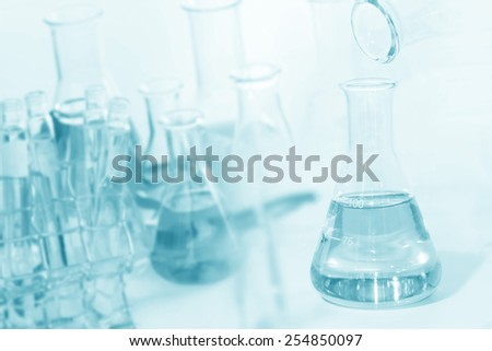 researcher pour the solution from flask to another flask in laboratory  - stock photo