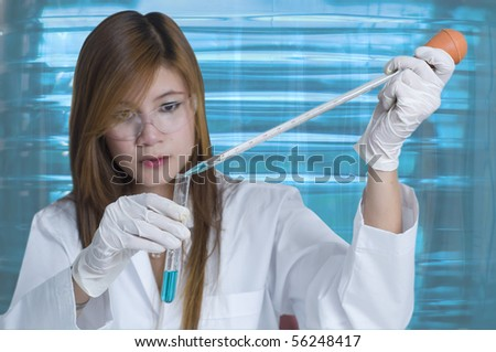 Researcher pouring chemicals in a laboratory - stock photo