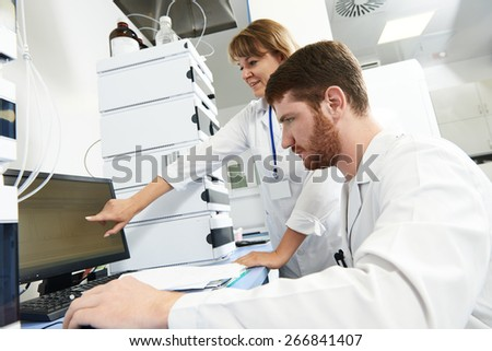 researchers team work on computer with scientific analysing data out scientific test in chemistry laboratory - stock photo