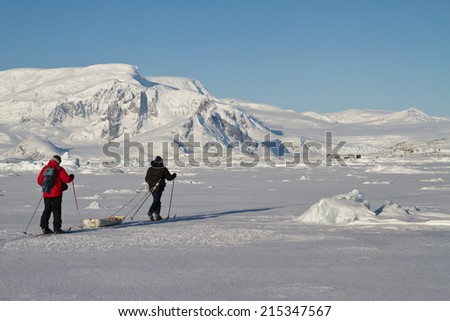 researchers who go skiing in the winter Antarctic - stock photo