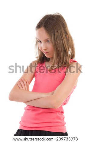 Resentful girl with arms and legs crossed looking down. Waist up studio shot isolated on white. - stock photo