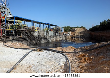 Reserve pit at a drilling rig - stock photo