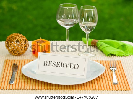 Reserved sign in dinner plate - stock photo
