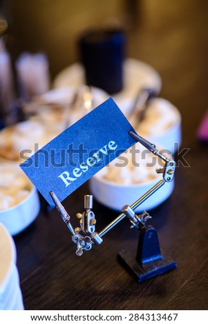 Reserved sign in freaky mechanism/Freaky reserved sign - stock photo