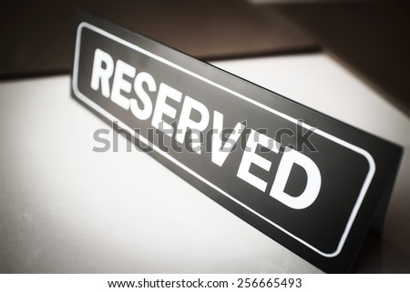 reserved sign in restaurant - stock photo