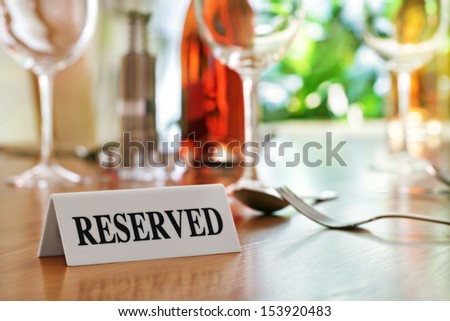 Reserved sign on a restaurant table - stock photo