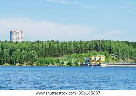 Reservoir Beloyarskay nuclear power plant on a clear summer day - stock photo