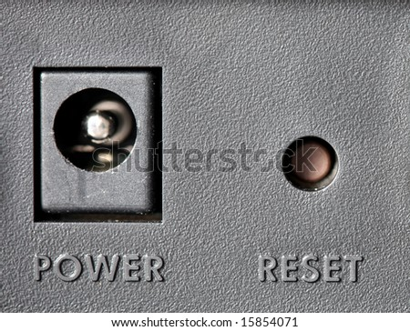 Reset button, modem power, macro. - stock photo