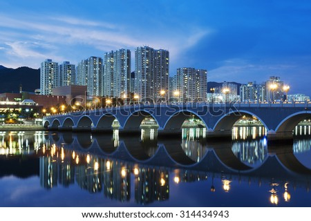 Residential building and bridge in Hong Kong - stock photo