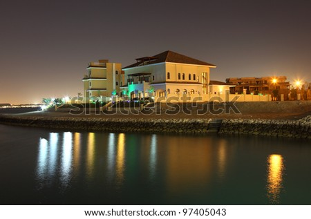 Residential buildings at night in The Pearl, Doha Qatar - stock photo