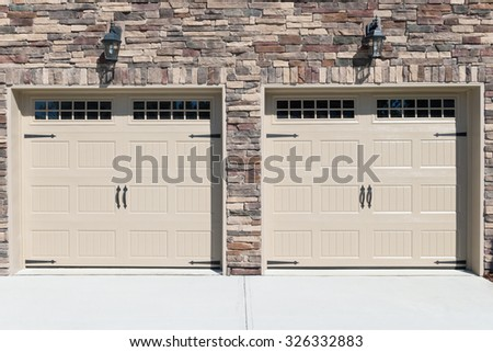 Residential house car garage doors - stock photo