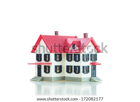 Residential house small model over the white background - stock photo