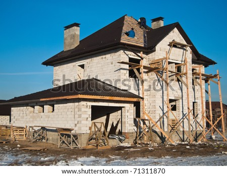 residential house under construction - stock photo
