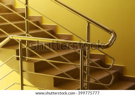 residential house with stainless steel banister, stairs and hallway background - stock photo