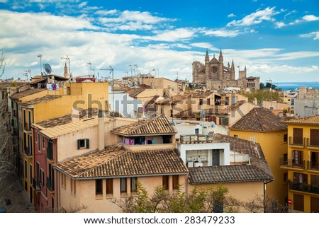 residential houses and Cathedral La Seu in the distance, Palma de Mallorca, Spain - stock photo