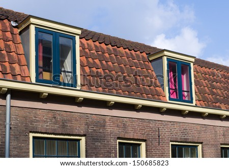 residential houses with dormer windows - stock photo