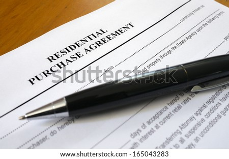 residential purchase agreement - stock photo