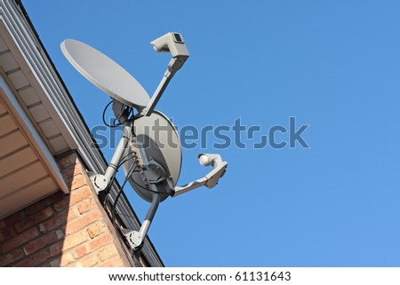 Residential satellite dishes pointing to the sky - stock photo