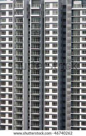 Residential skyscraper close-up in Kuala Lumpur, Malaysia. Urban background texture. - stock photo