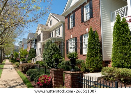 Residential street in spring - stock photo