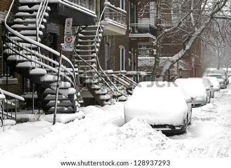 residential street of montreal canada in the winter - stock photo