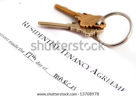residential tenancy agreement  keys to the side - stock photo