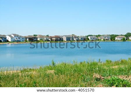 Residential Upscale Lakeside Neighborhood - Residential suburban homes in an upscale lakeside community in the summertime. - stock photo