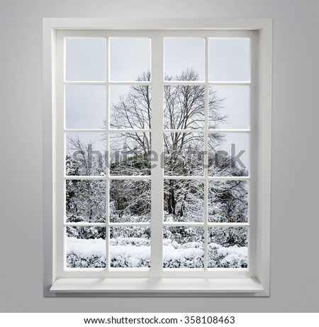 Residential window with snow and trees - stock photo