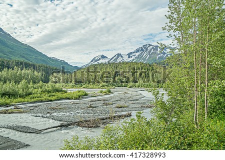 Resolution Bay, near Seward, Alaska, rugged mountains and sparkling waters.  - stock photo