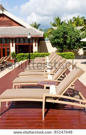 Resort lounge chairs - stock photo