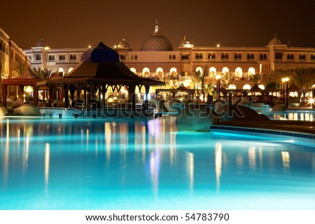resort pool at evening - stock photo