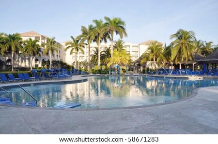 Resort pool at sunrise in Jamaica - stock photo