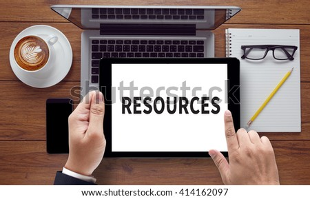 RESOURCES, on the tablet pc screen held by businessman hands - online, top view - stock photo