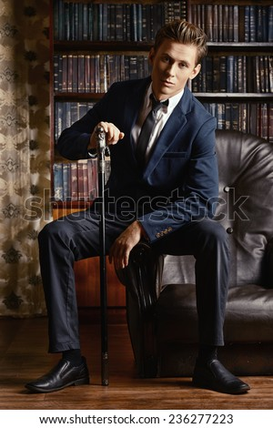 Respectable handsome man in his office. Classic vintage style. - stock photo