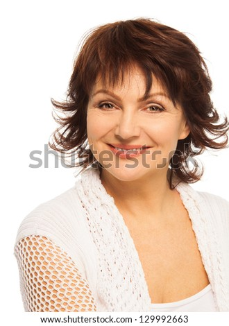 Respectful happy smiling adult woman - shoulder and head portrait - stock photo
