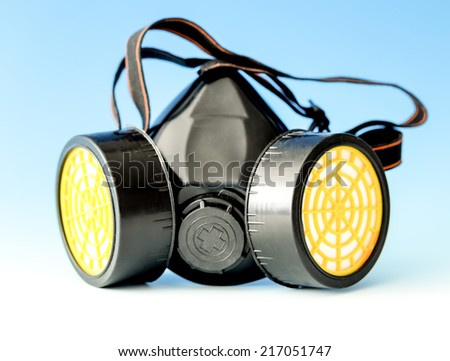 respiratory protection mask on blue - stock photo