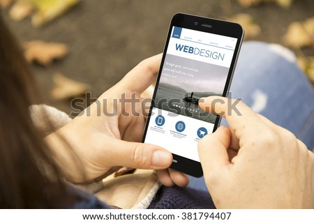 responsive fluid design concept: woman holding a 3d generated smartphone with web design site on the screen. Graphics on screen are made up. - stock photo