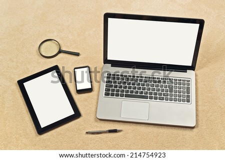 Responsive Web Design conceptual backdrop including digital tablet, mobile smartphone and laptop computer with blank white screen as copy space for your design mockup - stock photo