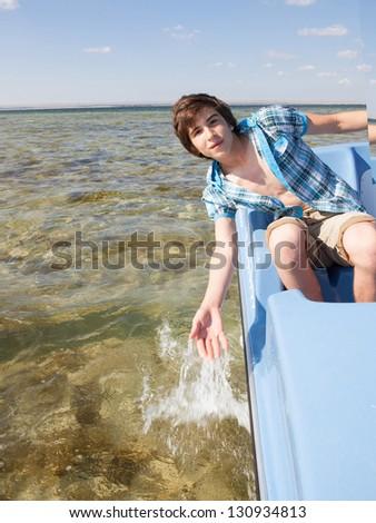 rest on karamaran in sunny summer day - stock photo