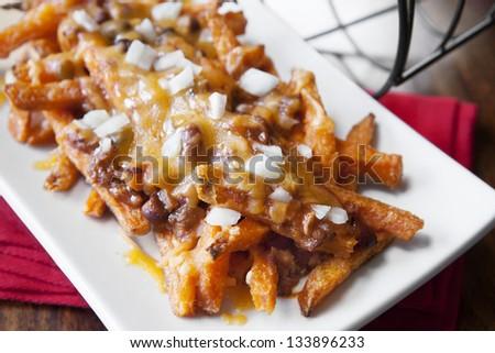 Restaurant Chili Cheese Fries, Sweet Potato Chili Cheese French Fries - stock photo