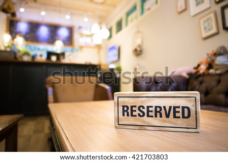 Restaurant , Coffee shop reserved table sign with places setting and wine glasses - stock photo