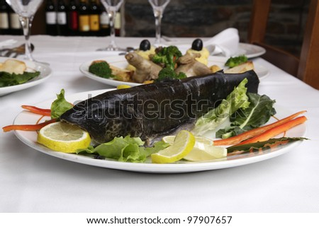 Restaurant dish - wild trout before being cooked - stock photo