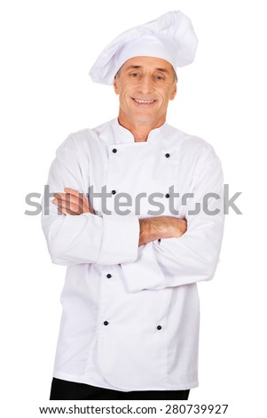 Restaurant experienced chef standing with folded arms - stock photo