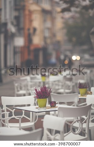 Restaurant exterior with table and chairs at the town street - stock photo