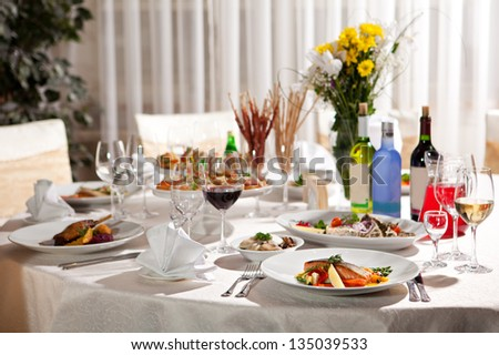 Restaurant Food - Salmon Steak and Goose Legs - stock photo