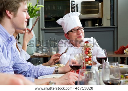 Restaurant guests talking to the chef during dinner - stock photo